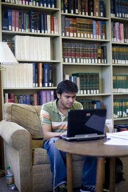 OIGA student in library HALF