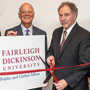 Image: Patrick Zenner, chair, FDu Board of Trustees, and FDU alumnus James Orefice, cut a ribboin symbolizing the creation of the School of Public and Global Affairs, for which Orefice donated $2.5 million to fund.