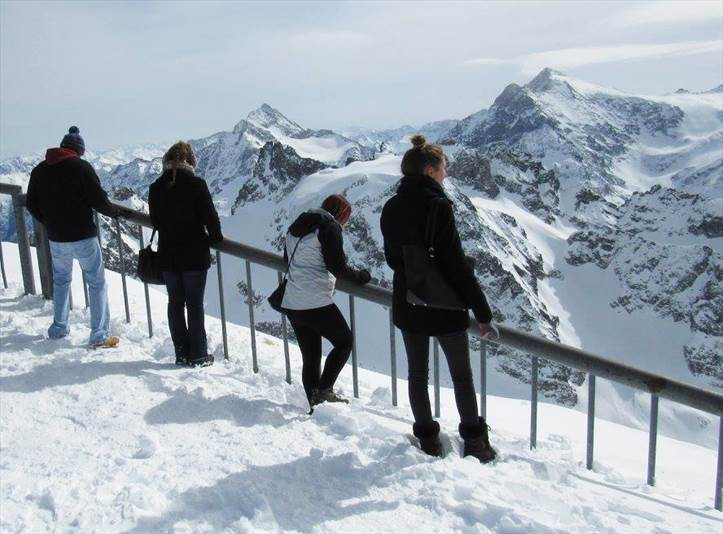 Travelers atop Mount Titlis in Switzerland