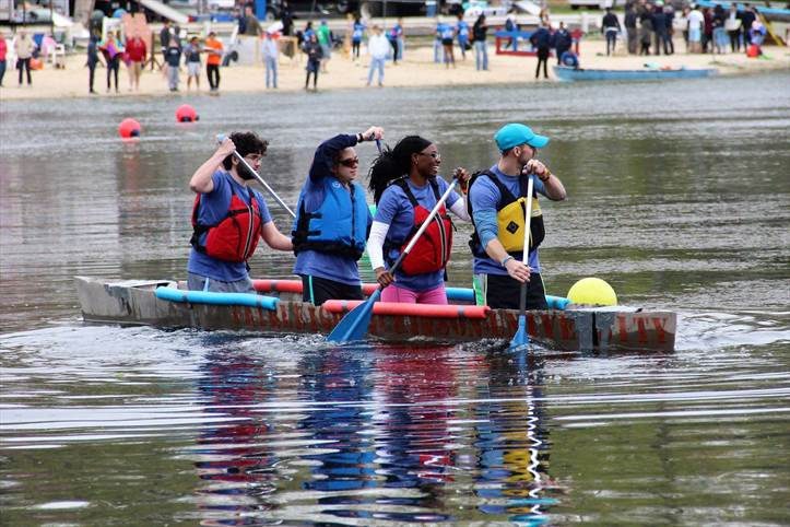 Students paddle the canoe