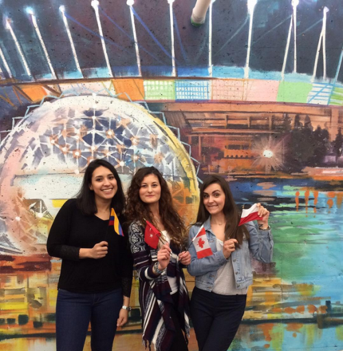 Vancouver students smile in front of the mural